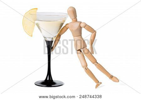 Wooden Mannikin Standing Near Glass Of Vermouth. Concept Of Drunkenness, Alcohol Abuse. Isolated On