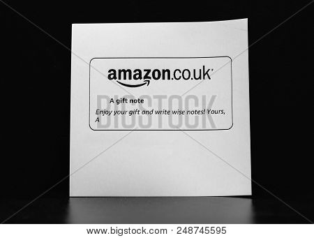 London United Kigdom - Jan 26 2018: Amazon.co.uk Gift Paper Slip With Mesage To Friend Against Black