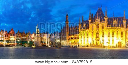 Panoramic View Of Typical Flemish Colored Houses And Statue Of Jan Breydel And Pieter De Coninck On