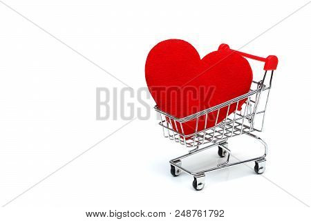 A Shopping Cart With A Big Red Heart / Online Dating Concept