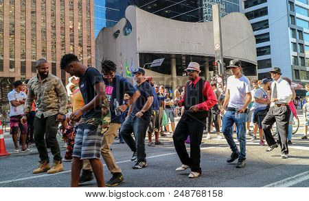 Sao Paulo, Brazil - July 8, 2018: An Unidentified Group Of People Dancing At Street At Paulista Aven