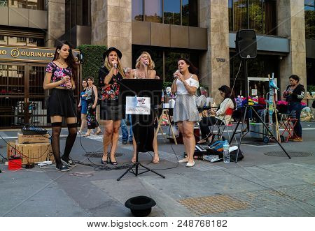Sao Paulo, Brazil - July 8, 2018: An Unidentified Group Of Girls Singing Together At Paulista Avenue