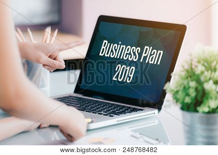 Business People Meeting In Front Of Laptop Computer Screen With Business Plan 2019 Word On Desk At O