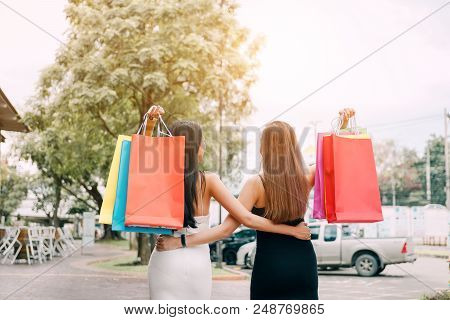 Rear View With Two Beautiful Asian Woman Holding Shopping Bag At Shopping Market Outdoor.
