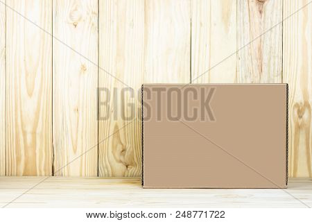 Blank Brown Box On Wooden Table.zoom In
