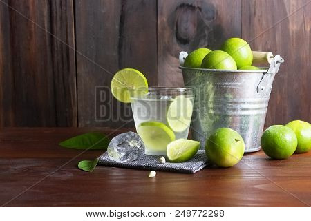 Lime Juice Or Lime Lemonade Or Green Lemon With Lemon Tank On Wooden Table ,close Up.