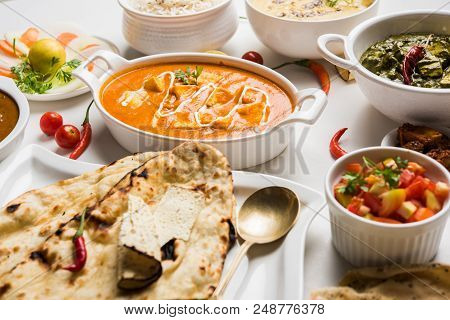 Assorted Indian Food For Lunch Or Dinner, Rice, Lentils, Paneer, Dal Makhani, Naan, Chutney, Spices