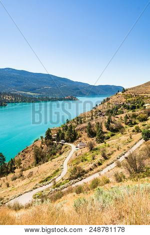 Great View On Kalamaka Lake In British Columbia, Canada. Large Luxury Houses On The Lake Shore With