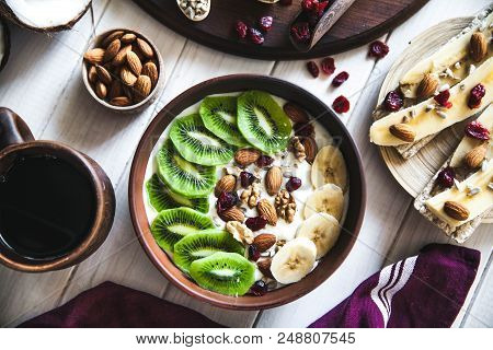 Yogurt With Different Fruits On A Wooden Background. Useful Food, Diet, Organic. A