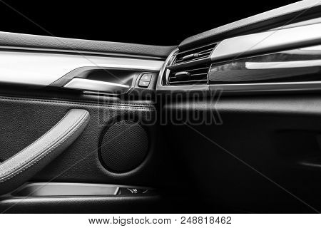 Door Handle With Power Window Control Buttons Of A Luxury Passenger Car. Black Leather Interior Of T