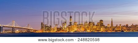 San Francisco downtown skyline at dusk from Treasure Island, California, sunset, USA. Panorama
