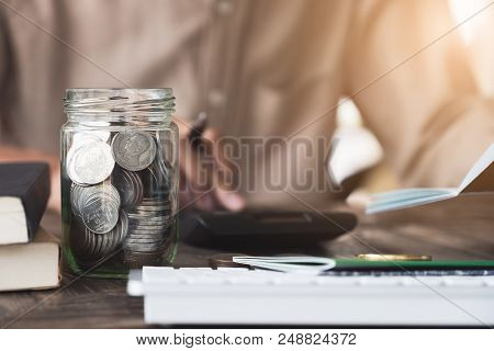 Accountant Calculating  The Saving Account Book And Statement Of Financial Statements At Home. Accou