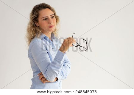 Pensive Dreamy Business Lady Holding Glasses And Looking Away. Thoughtful Attractive Female Analyst