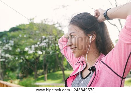 Close Up Of A Happy Young Asian Woman Warming Up Her Body By Stretching Her Body Before Morning Exce