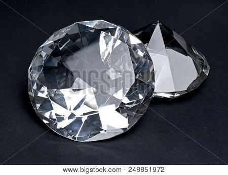 Beautiful Shiny Diamonds, Isolated On Black Background. Clear Or Transparent Diamonds, Close-up Shot