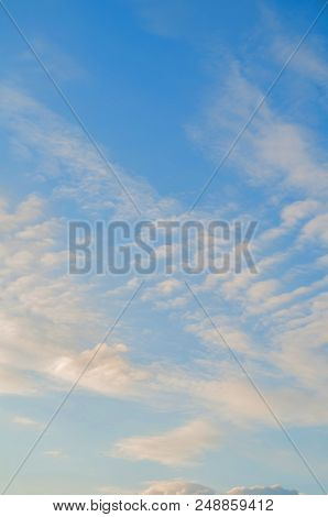 Blue Sky Sunset Landscape With Dramatic Clouds Lit By Soft Evening Sunshine - Colorful Evening Sky V