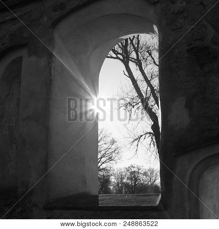 Sunlight Shining Through A Window At The Björkvik Church Ruin.