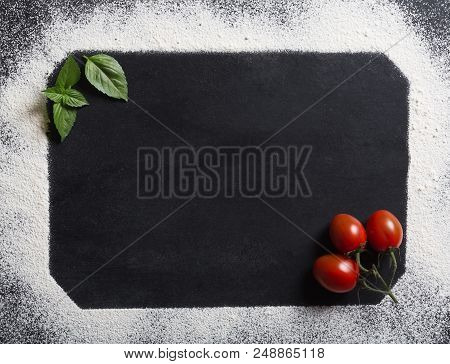 Baking Background With Copy Space On Black Surface For Your Text. Top View. Flour Is A Traditional I