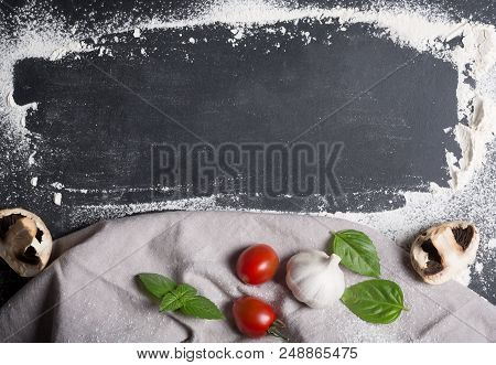 Baking Background With Copy Space On Black Surface For Your Text. Flour And Vegetables Are Tradition