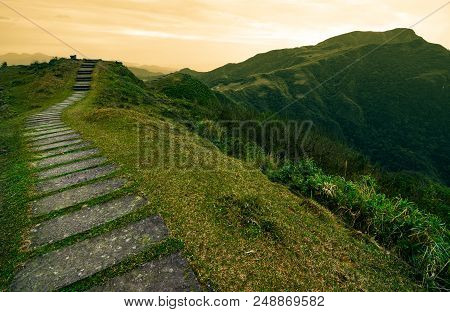 Stepping Stone Footpath Leading Over A Hill Into A Storybook Landscape On The Taoyuan Valley Trail I