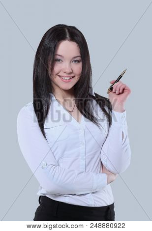 Successful business posing against gray background.