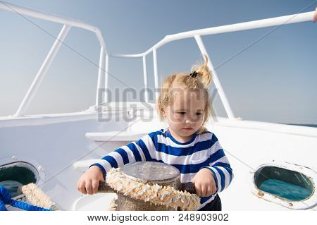 Lower The Anchor. Adventure Boy Sailor Travelling Sea. Child Cute Sailor Help With Ropes Yacht Bow.
