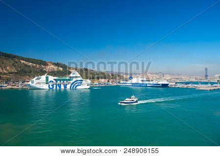 Barcelona, Spain - March 30, 2016: Ships Gnv And Grimaldi Lines In Sea Port. Travelling By Sea. Summ