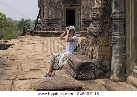 Tourist Woman Making Pictures In Pre Rup Temple, Angkor Wat Complex, Cambodia. Tourist Photographer