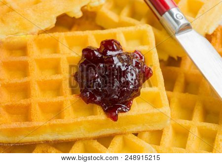 Close-up Of Brown Waffles With Homemade Marmelade. View To Stacked Wafles With Jam. Bakery And Food
