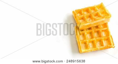 Fresh Brown Waffles On A White Clean Background. View From Above To Baked Wafles. Bakery And Food Ba