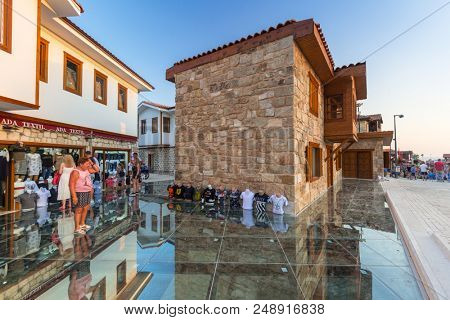 Side, Turkey - June 8, 2018: People in the shopping area of Side town, Turkey. Side is an ancient Greek city on the southern Mediterranean coast of Turkey.