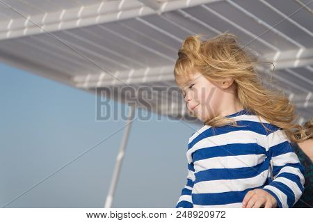 Unforgettable Family Vacation At Sea. Child Happy Face Striped Shirt Sailor. Child Enjoy Vacation On
