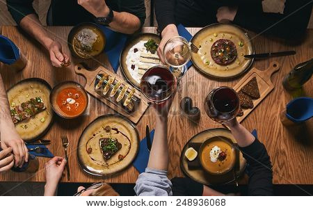 Table With Food, View From Above. Friendly Dinner. Top View Of Group Of People Having Dinner Togethe