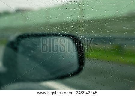 Rainy Day In Highway. Rainy Day In The Car. Rain Drops On The Car Glass.driving Fast On Highway. Loo