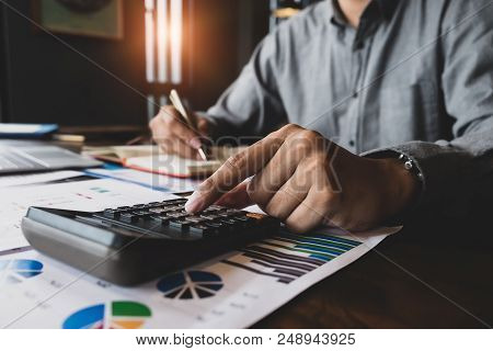 Bookkeeper Accounting Concepts, Male Use Calculator To Monitor Money Saving Reports Budget To Plan B