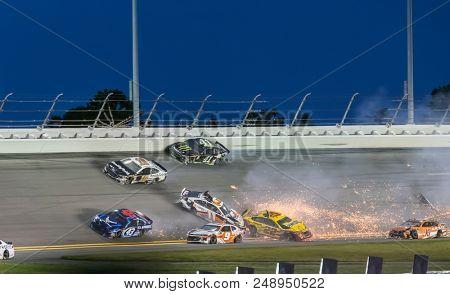 July 07, 2018 - Daytona Beach, Florida, USA: {persons} crashes through the field off turn four at the Coke Zero Sugar 400 at Daytona International Speedway in Daytona Beach, Florida.