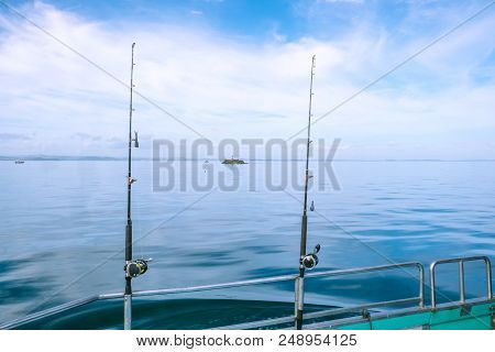 Fishing Rods With Sinkers And Reels On A Charter Boat On Calm, Tranquil Sea In Far North District, N