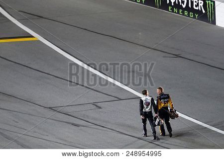 July 07, 2018 - Daytona Beach, Florida, USA: Clint Bowyer (14) and Kevin Harvick (4) walk to an ambulance after being involved in a wreck during the Coke Zero Sugar 400 at Daytona International Speedw