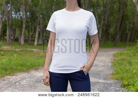 Cropped Image Of Young Hipster Girl Wearing Blank White T-shirt And Black Jeans, Mock-up Of Blank Wh
