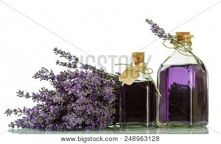 Tincture Of Lavender In Bottles With Corks Isolated On White Background