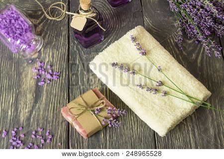 Handmade Soap, Sea Salt And Lavender Tincture, Terry Towel On Wooden Surface