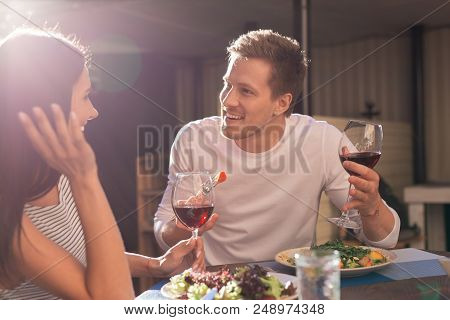 Joining For Dinner. Prosperous Busy Businessman Feeling Relaxed While Joining His Appealing Girlfrie