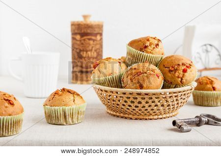 Several Homemade Muffins With Dried Fruits In A Wicker Basket Close-up