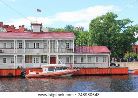 St. Petersburg, Russia - June 18, 2018: Patrol Lifeboat On Neva River Water In Front Of Rescue Stati