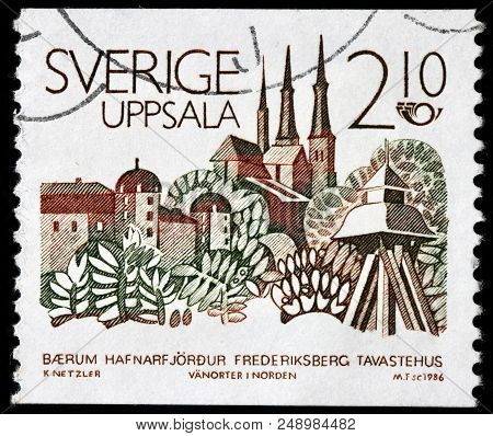 Luga, Russia - June 07, 2018: A Stamp Printed By Sweden Shows Beautiful View Of Uppsala - The Capita