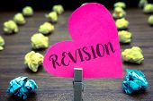 Writing note showing Revision. Business photo showcasing Rechecking Before Proceeding Self Improvement Preparation Paper objects thoughts hart crumpled papers mistakes several tries poster
