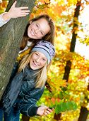 Beautiful Teenage Girls Having Fun in Autumn Park .Outdoor poster