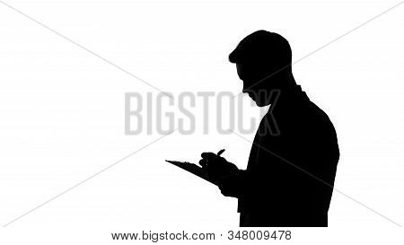 Man Silhouette Writing Answers Into Questionnaire Sheet, Statistical Surveys