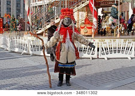 Moscow, Russia - March 07, 2019: Woman Dressed In Vintage Costume And Scary Mask At Russian National