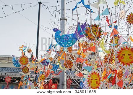 Moscow, Russia - March 07, 2019: Toys Birds And Suns As Shrovetide Decorations Hanging On The Branch